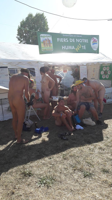 nude naturists at an exhibition in Paris, France